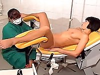 Kinky slut fisted on a gyno chair by a horny nurse