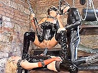 Latex clad and masked slut gets fisted up her twat